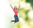 smiling young woman jumping in air