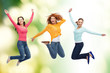 group of smiling young women jumping in air