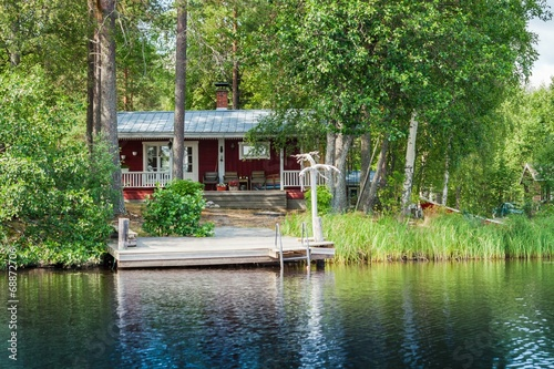 Photo  Old Finnish summer cottage at a lake