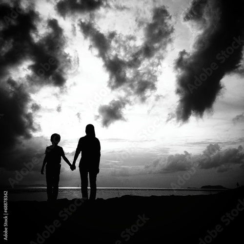 mother and son in silhouette