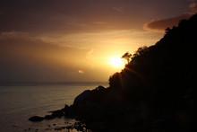 Radiant Sun Rising Over The Sea