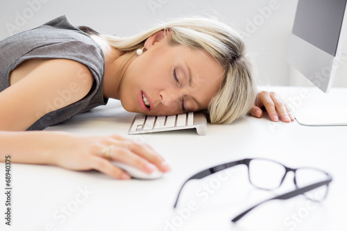 Fotografie, Obraz  Exhausted woman sleeping in front of computer