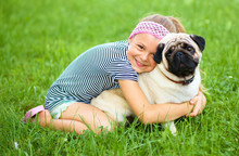 Little Girl And Her Pug Dog On...