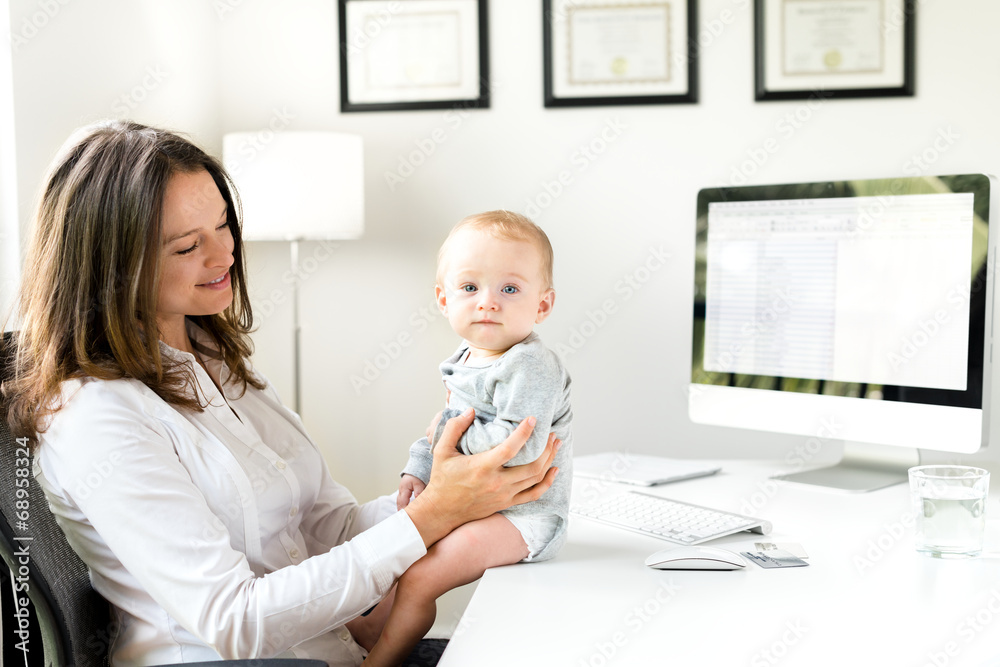 Fotografering  Businesswoman in Office with Baby