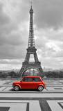 Fototapeta  - Eiffel tower with car. Black and white photo with red element.
