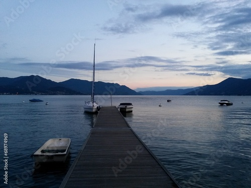 Fotografie, Obraz  jetty and boats at sunset on the lake