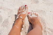 Relaxing At A Beach, With Your Feet On The Sand.