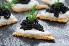 Crackers With Cream Cheese And Black Caviar