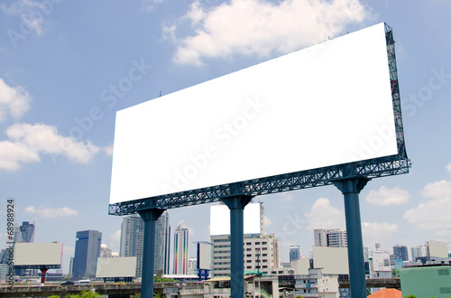 Fotografía  large blank billboard on road with city view background