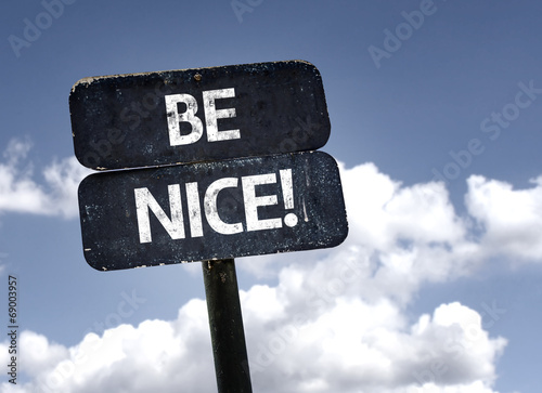 Be Nice sign with clouds and sky background Canvas Print