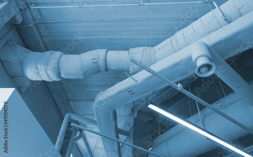 Industrial steel ventilation pipes inside of building. Canvas Print