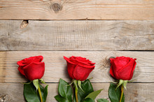 Red Roses On Wooden Background