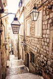 Fototapeta  - Steep stairs and narrow street in old town of Dubrovnik
