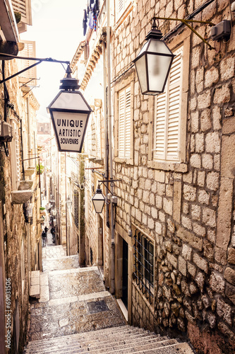 Poster Smal steegje Steep stairs and narrow street in old town of Dubrovnik