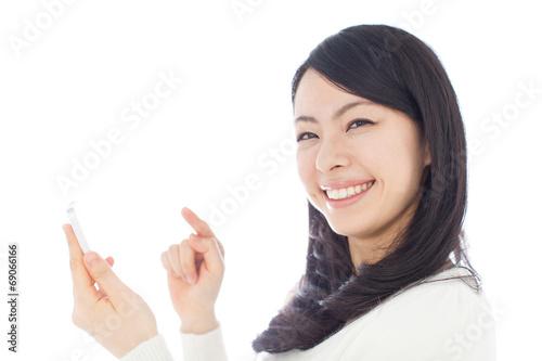 Fotografie, Obraz  スマートフォンを使う女性