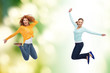 smiling young women jumping in air