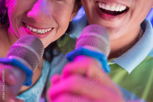 Photo  Singing with microphones
