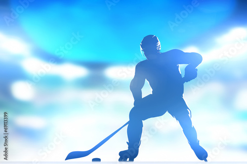 Photo  Hockey player skating with a puck in arena lighs