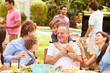 canvas print picture - Multi Generation Family Enjoying Meal In Garden Together