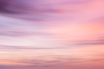Defocused sunset sky background with blurred panning motion.