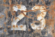 Number 23 On Rusty Metal Surface