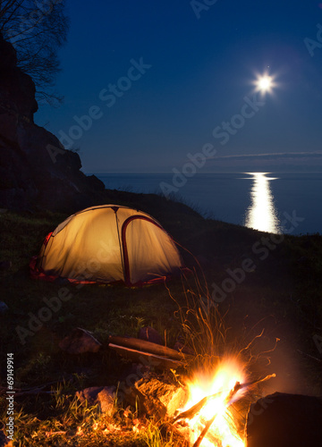 Photo Stands Camping Tourist camping with bonfire at night