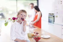 Young Boy Eating  Strawberries...
