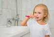 Girl with toothbrush washes