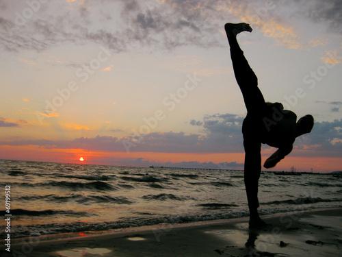 calcio al tramonto Fototapeta