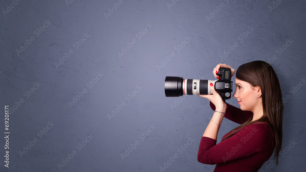 Fototapety, obrazy: Photographer shooting images with copyspace area
