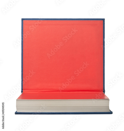 Valokuva  Hardback book with its cover flipped up isolated on white
