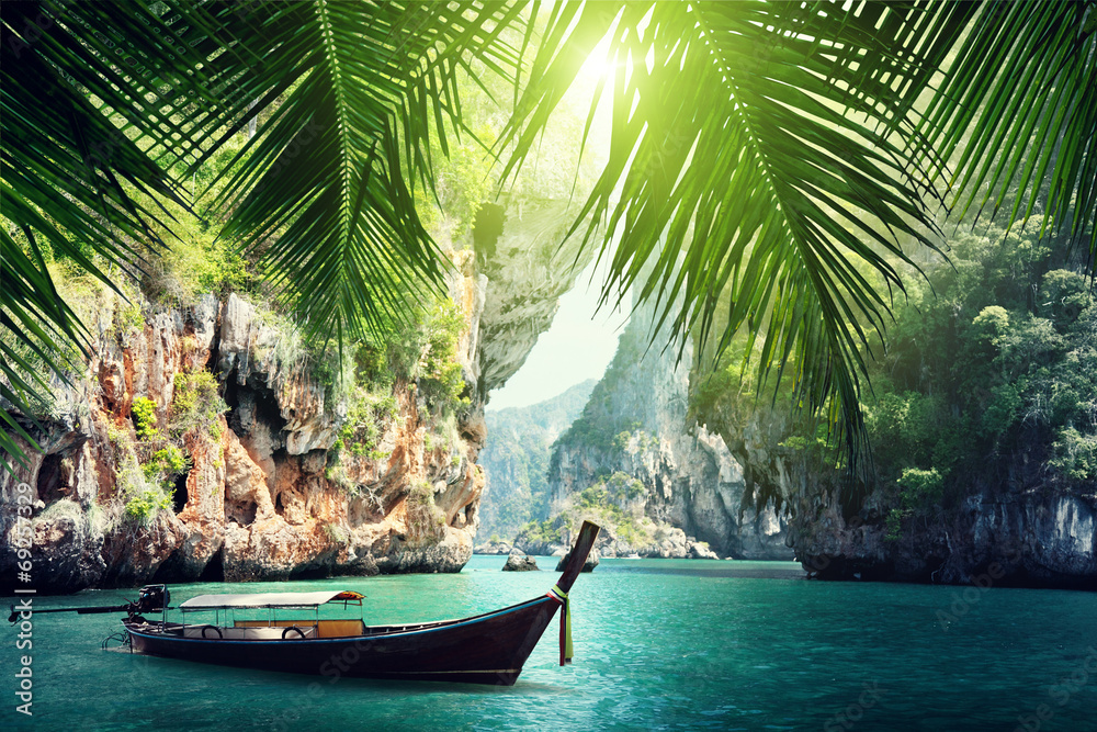 Fototapeta long boat and rocks on beach in Krabi, Thailand