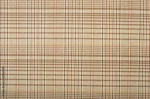 Photo  Brown and orange guncheck pattern. Tartan design as background.