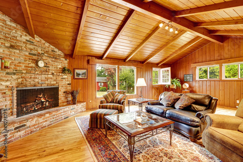 Luxury log cabin house interior. Living room with fireplace and Poster Mural XXL