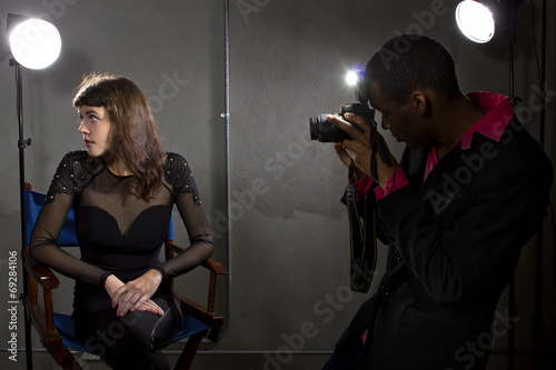 photographer taking an actress photo with flash strobes Canvas Print