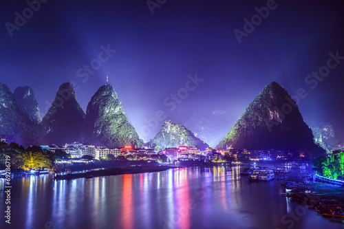 Fotobehang Violet Yangshuo, China Town Skyline with Karst Mountain Landscape