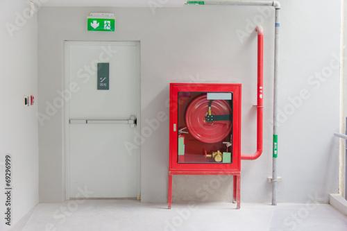 Fotografija Fire exit door and fire extinguish equipment