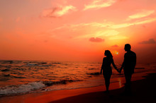 A Couple In Love Walking At Sundown