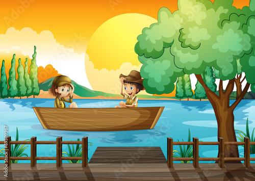 Aluminium Prints River, lake A boy and a girl at the boat