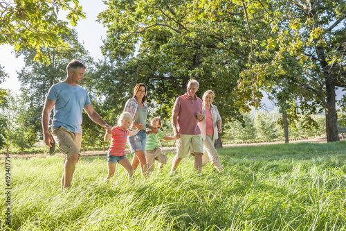 Fotografie, Obraz  Multi-Generation Family Enjoying Walk In Beautiful Countryside