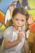 Portrait Of A Girl Eating An I...
