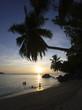People on beach at sunset, Anse a la Mouche, Mahe', Seychelles