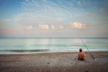 A Fisherman On The Beach In The Morning