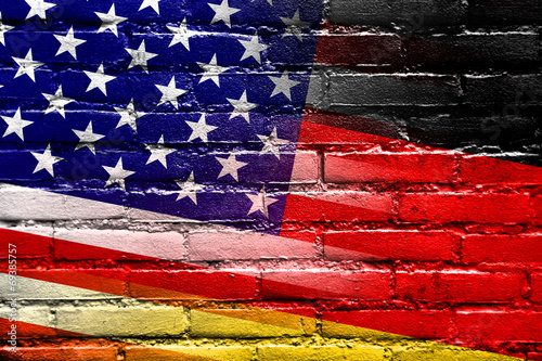 Fotografie, Obraz  USA and Germany Flag painted on brick wall