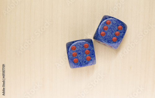 dice on a light wood surface, games плакат