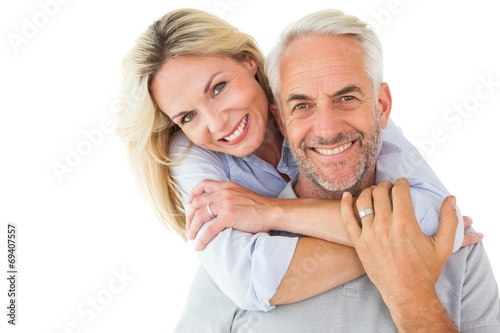 Fototapeta Happy couple standing and hugging