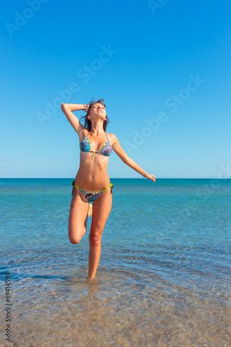Fotobehang womenART woman in bikini, outdoor on the beach