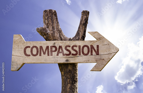 Valokuva  Compassion sign with a beautiful day on background