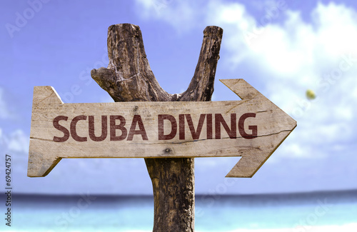 Fototapeta Scuba Diving wooden sign with a beach on background obraz