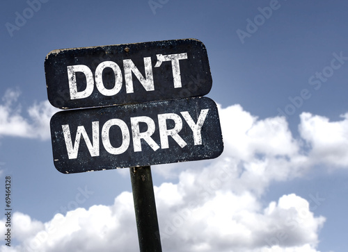 Photo  Don't Worry sign with clouds and sky background